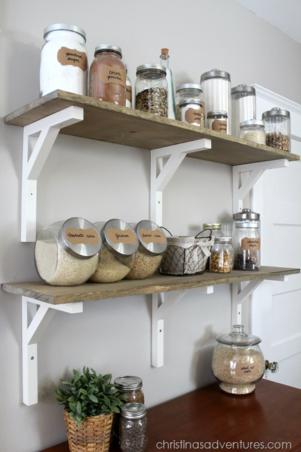 open shelving pantry : wood shelves + glass containers make this pantry beautiful. A dresser underneath adds character & hides items not displayed and adds storage space to a small kitchen