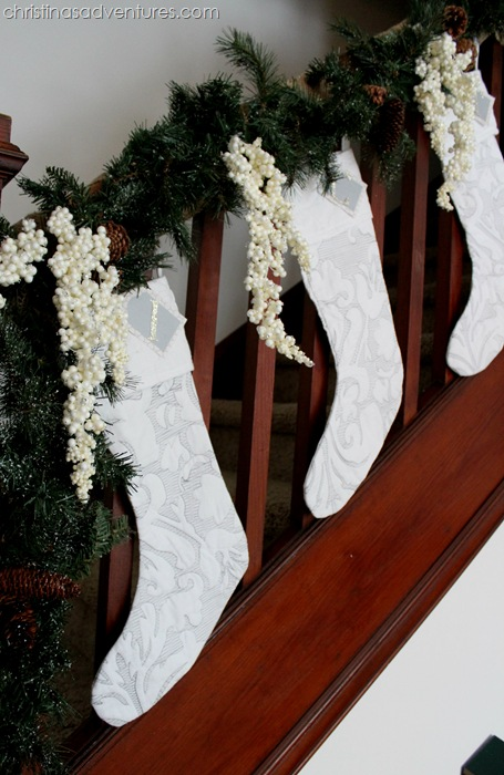 White stockings on the staircase with garland