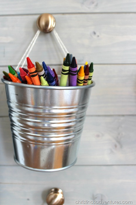 Crayon bucket hung by hardware