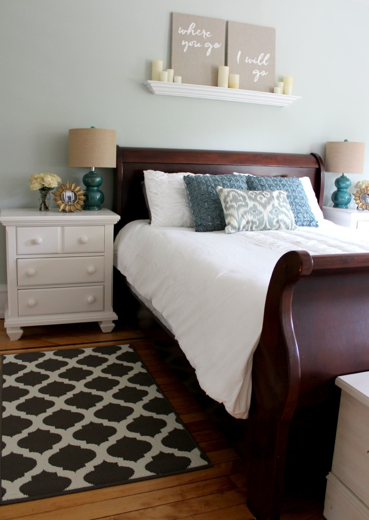 Dark sleigh bed with white nightstands