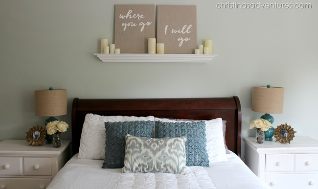 Canvases with candles on top of the bed