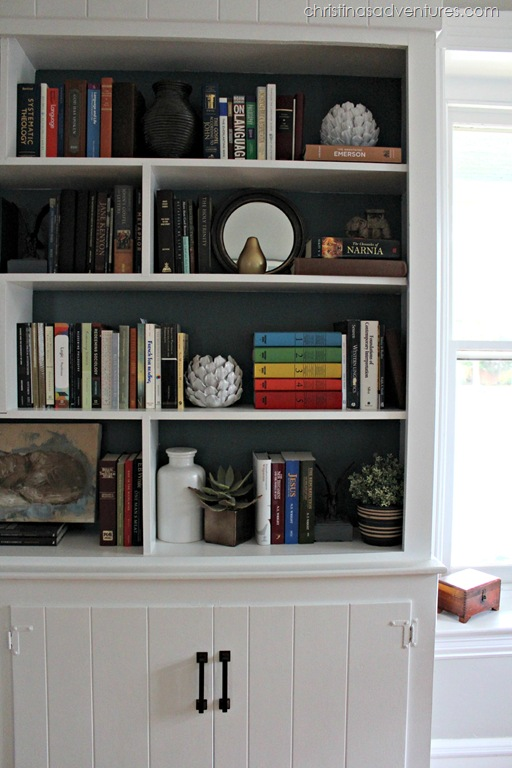 white built in bookshelves with relaxed navy by Valspar painted in the back