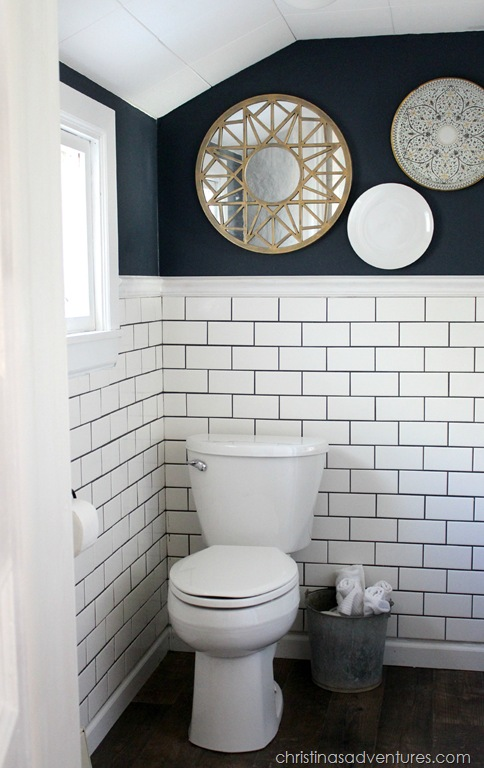 Small Bathroom makeover with hale navy paint and white subway tile