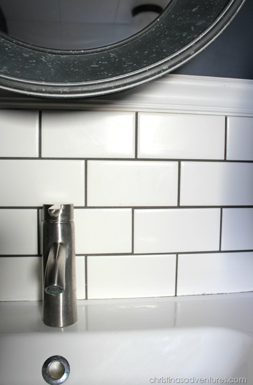 subway-tile-and-mirror-over-sink 7