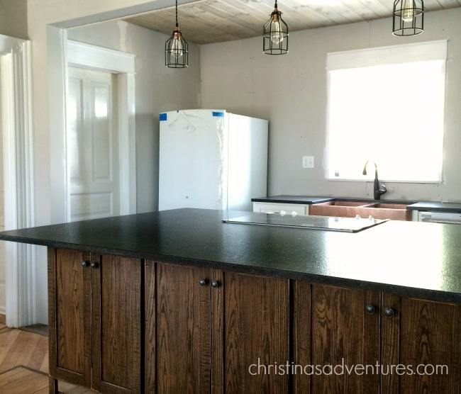 matte black granite counter tops on a wood island