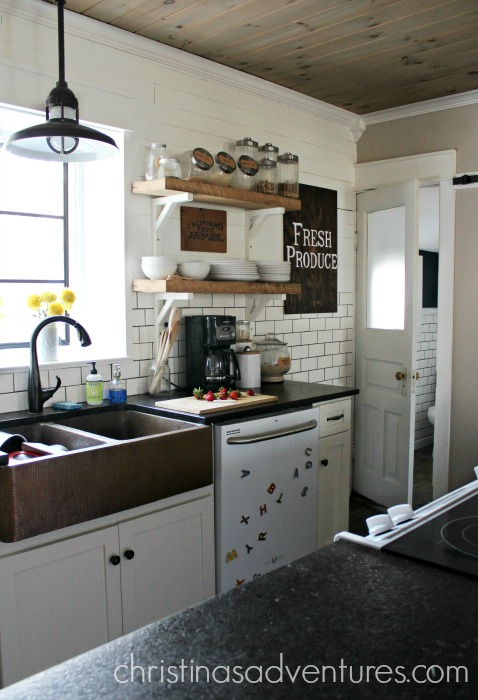 Farmhouse Kitchen With Copper Sink Black Counter Tops Open Shelving Subway  Tile And Shiplap