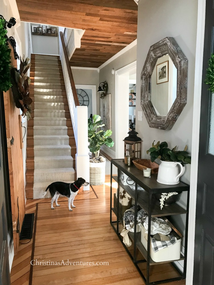 Love this hallway! Full of farmhouse charm with the wood ceiling, barn door, wood floors, stair runner, console table, and so many details you HAVE to see the whole makeover!