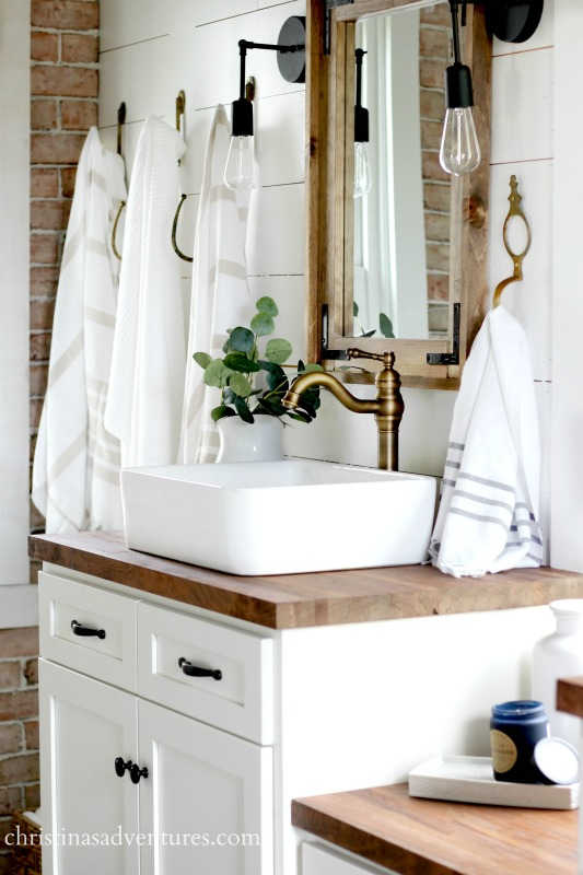 farmhouse-bathroom-with-a-brick-wall-and-butcher-block