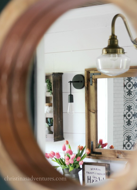 Vintage inspired farmhouse bathroom patterned tile aged brass wood tones and white shiplap