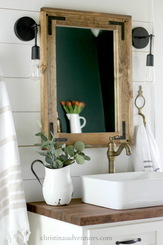 wood-framed-mirror-with-black-accents