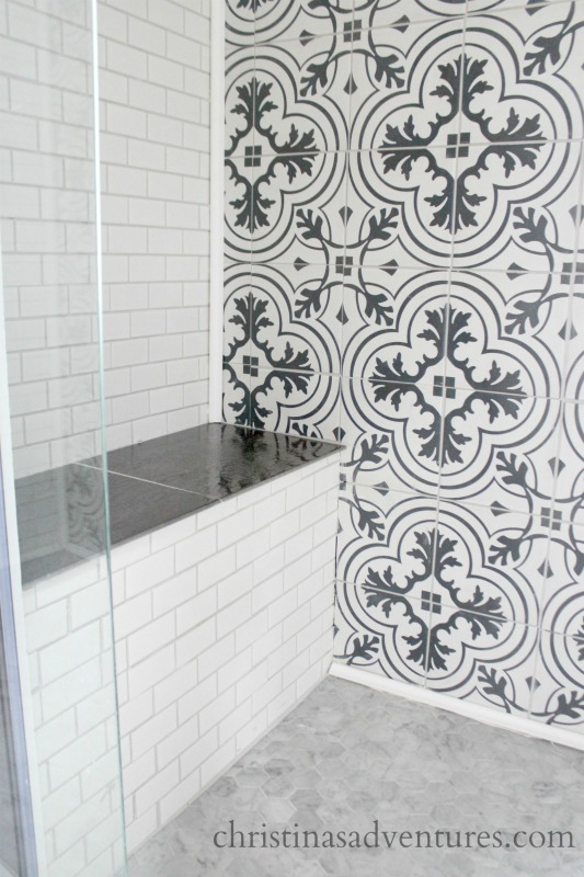 Built In Bench In Shower With Subway Tile And Black And White Patterned Tile  And Marble