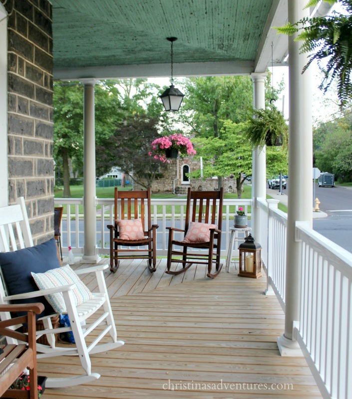Front porch rocking chairs wood and white with hanging plants