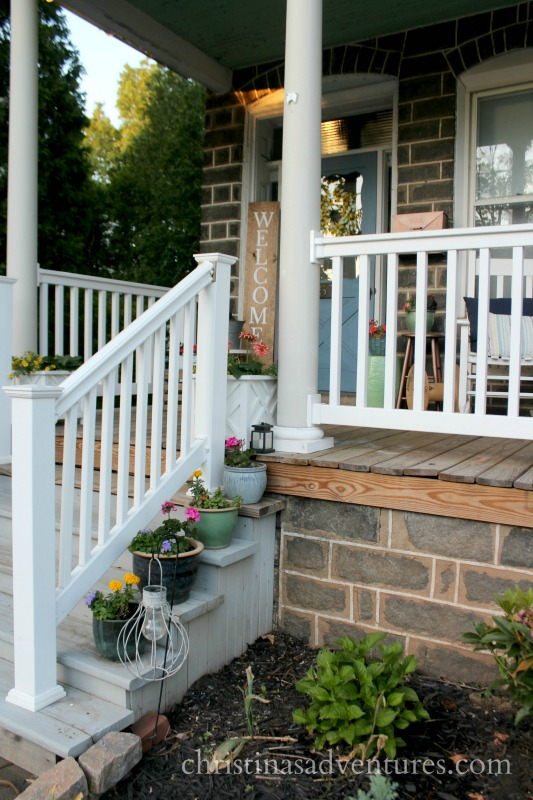 Front porch steps with a white railing