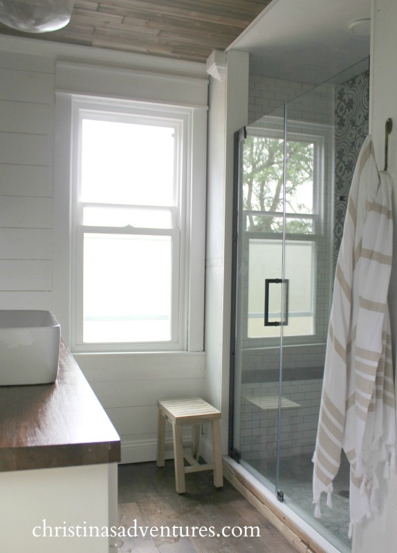 shower with glass door shiplap walls and wood ceiling farmhouse bathroom
