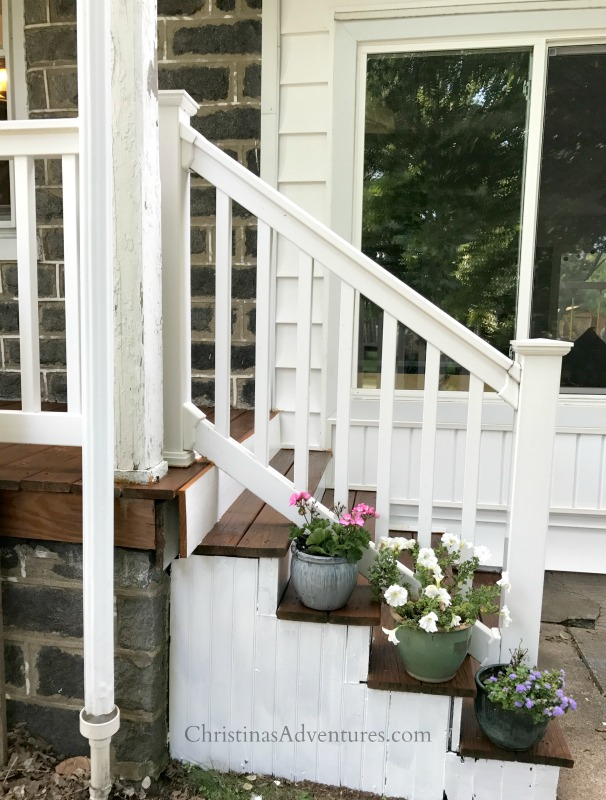 side porch steps white and wood flower pots