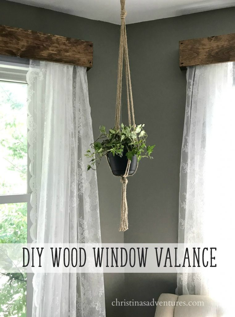 DIY wood window valance tutorial with lace curtains and hanging rope planter and dark gray walls. Perfect for farmhouse home decor.