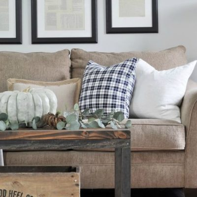 A touch of plaid is just lovely in this room from Little Glass Jar_. This family room keeps it casual with eucalyptus & pumpkins on the coffee table, and that cozy plaid pillow.