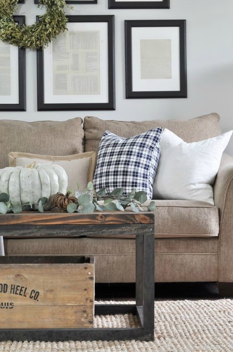 Fall family room decorating ideas - A touch of plaid is just lovely in this room from Little Glass Jar_. This family room keeps it casual with eucalyptus & pumpkins on the coffee table, and that cozy plaid pillow.