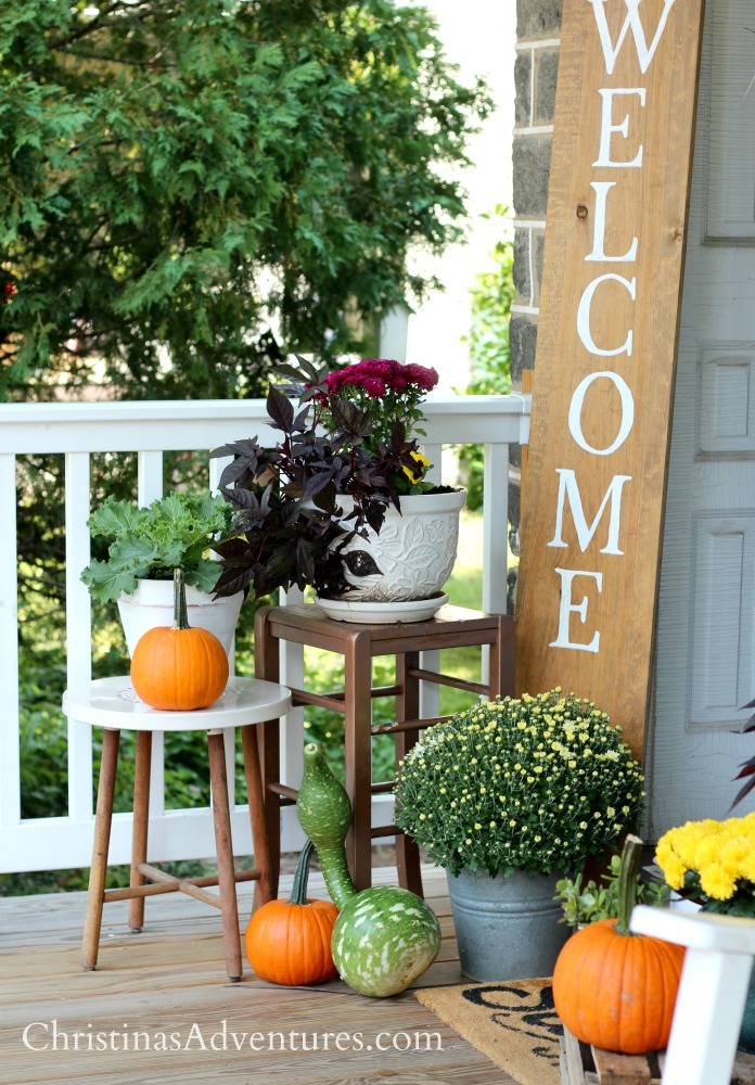 How to decorate your porch for fall - how to vary heights, add texture, use a variety of plants and pumpkins, and ideas for unconventional planters.