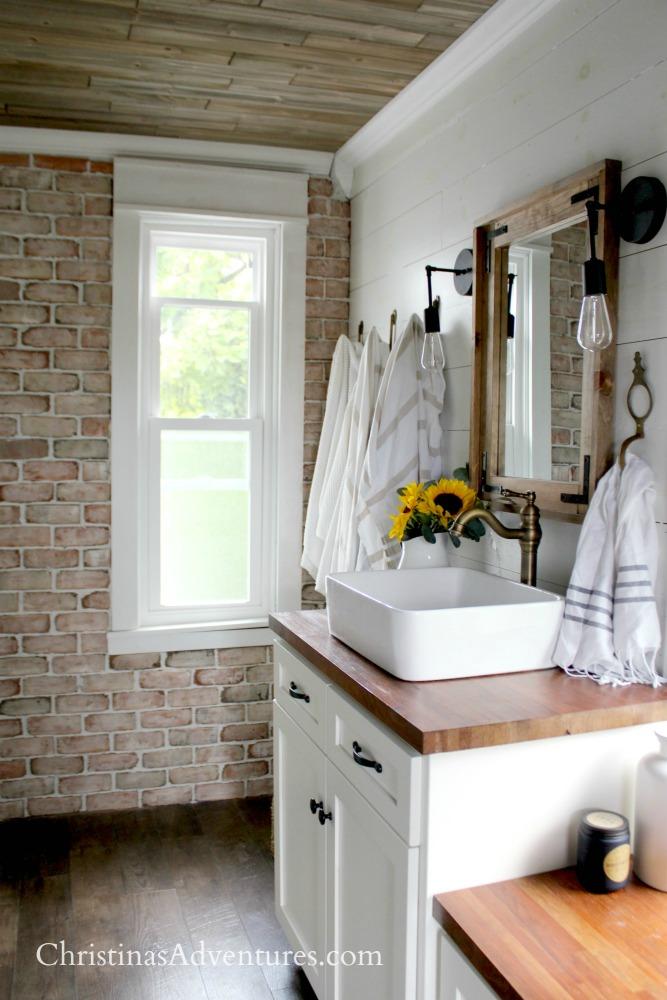 brick wall shiplap wall wood ceiling