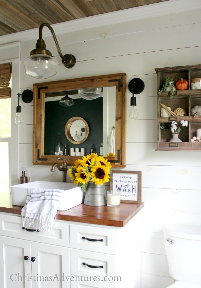 Farmhouse bathroom decorated for fall