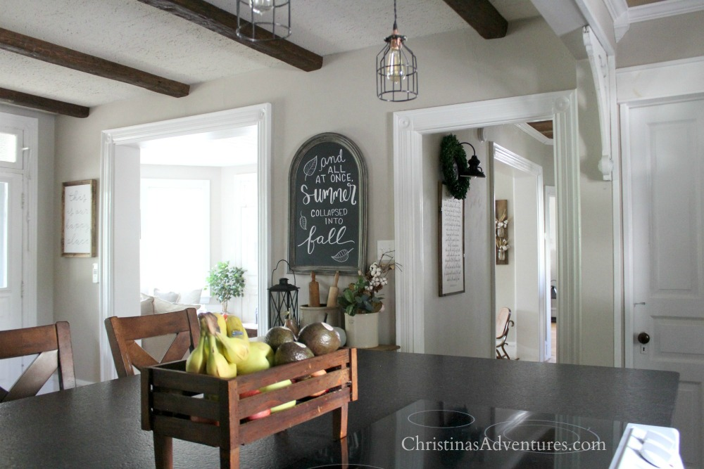 Farmhouse fall kitchen wood beams and arched chalkboard
