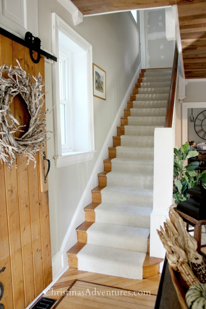 wood staircase with beige runner