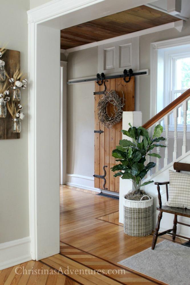 wood ceiling farmhouse hallway fiddle leaf fig