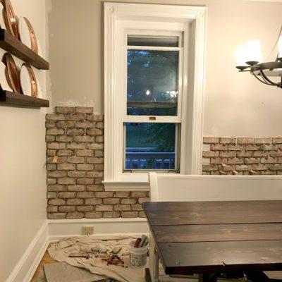Kitchen progress: brick wall, paint & our pew