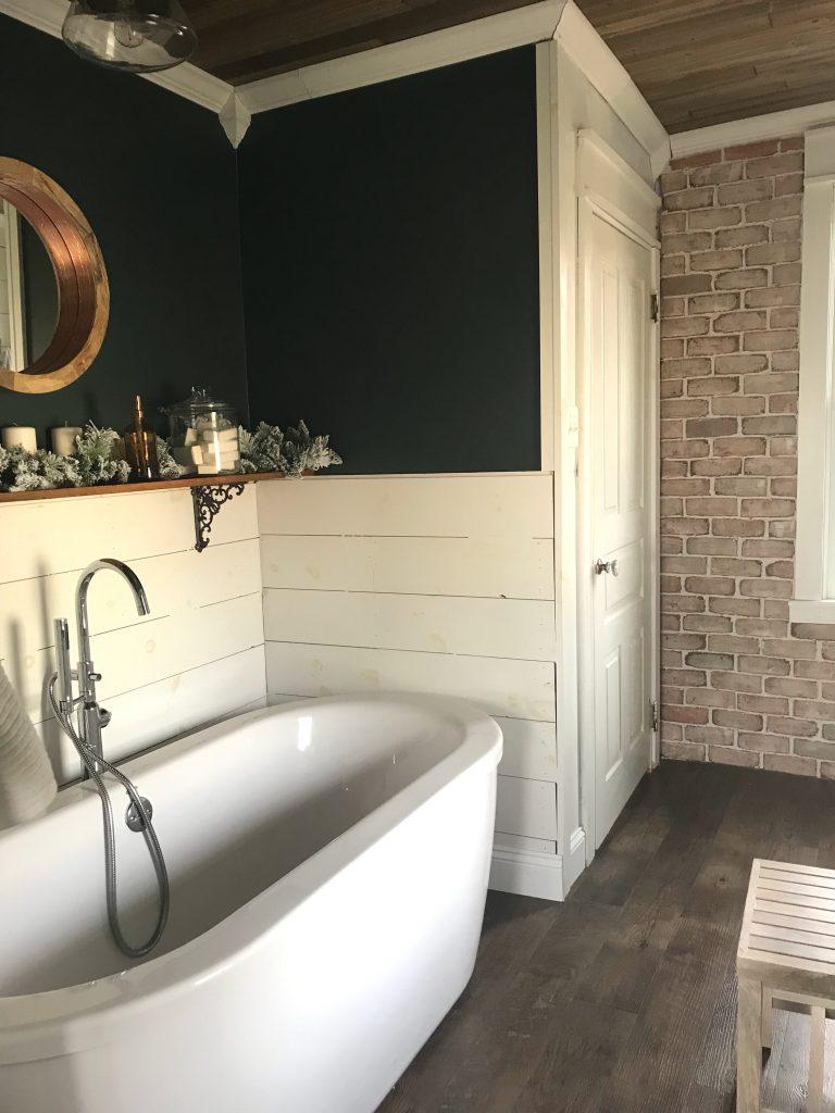Vintage inspired farmhouse bathroom shiplap dark green and brick wall