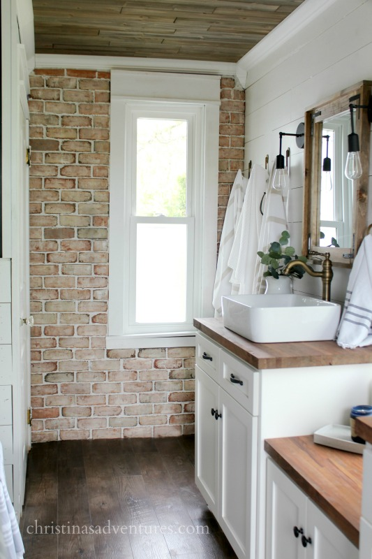 Brick Veneer Accent Wall In Vintage Inspired Farmhouse Bathroom With  Shiplap And Wood Ceiling