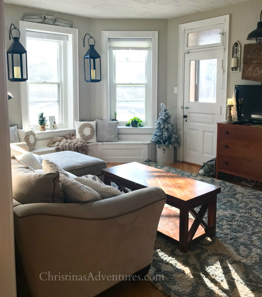 neutral family room with black lanterns