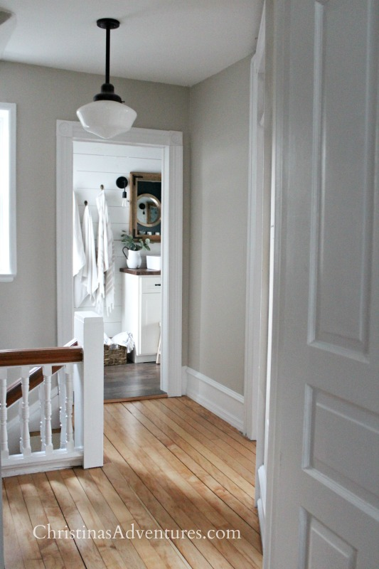 neutral hallway decorating with schoolhouse light and old trim