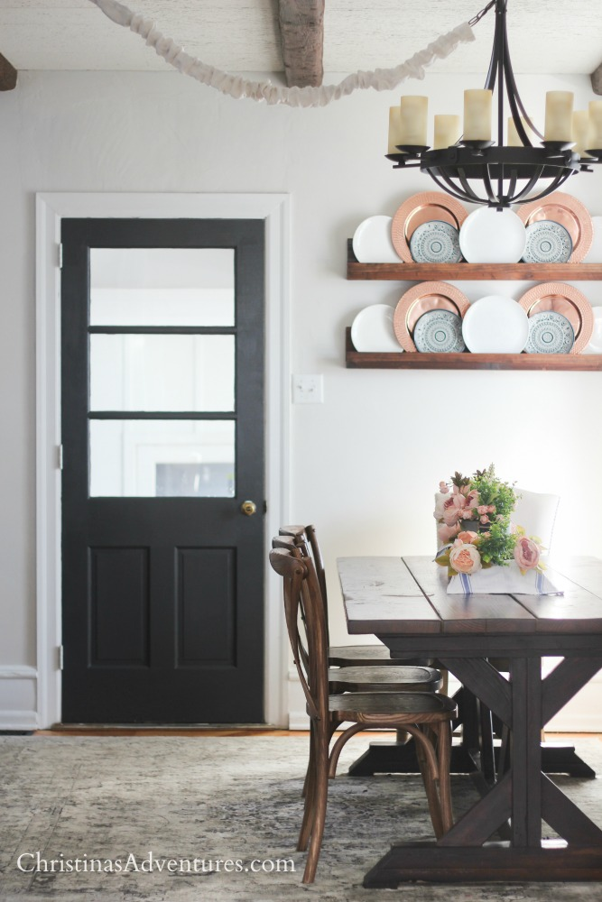 Dark gray interior door in a farmhouse inspired dining kitchen farmhouse table