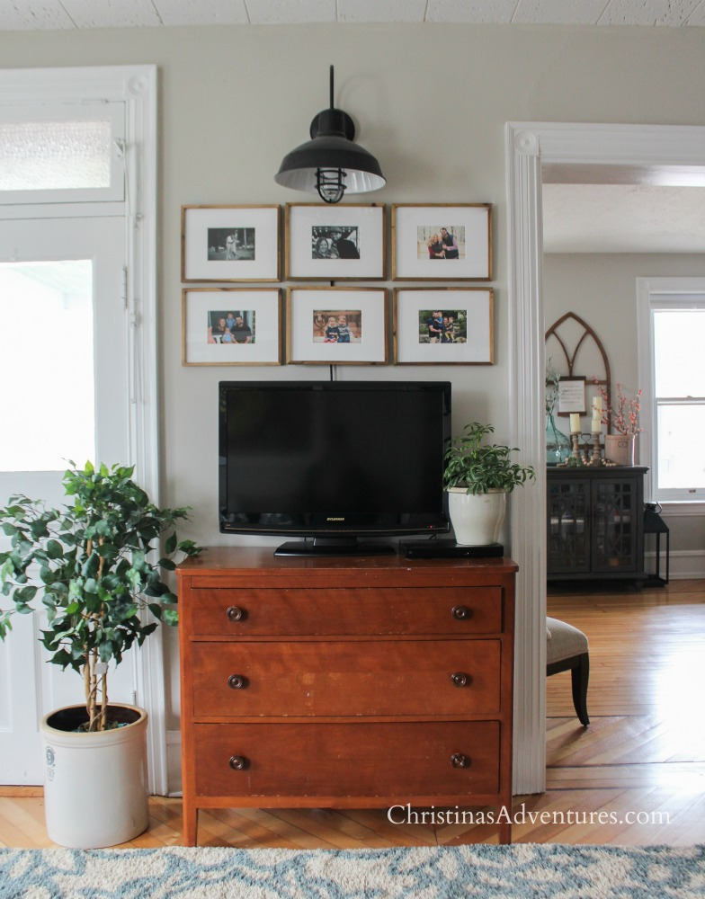 Use picture frames to decorate around a TV and make a gallery wall