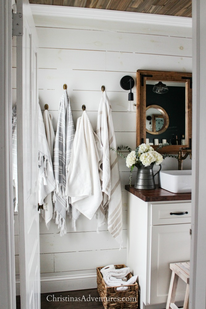 farmhouse bathroom shiplap walls wood ceiling and butcher block counter tops