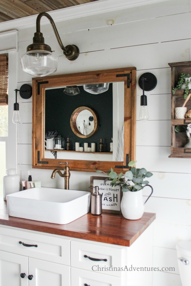 farmhouse bathroom white shiplap wood accents and enamelware with eucalyptus