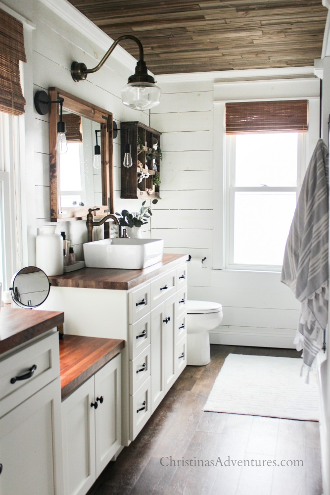farmhouse fixer upper bathroom with wood ceiling and white shiplap walls