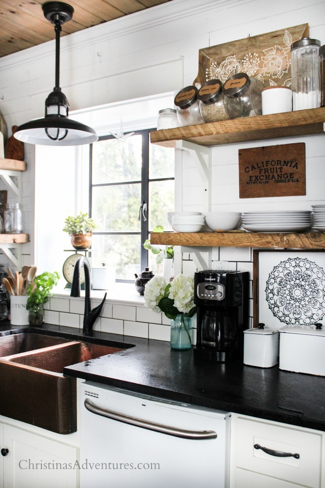 farmhouse kitchen with black framed window over the sink