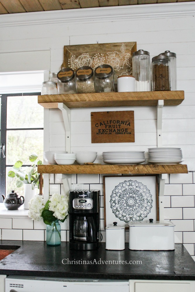 farmhouse style kitchen open shelving black countertops