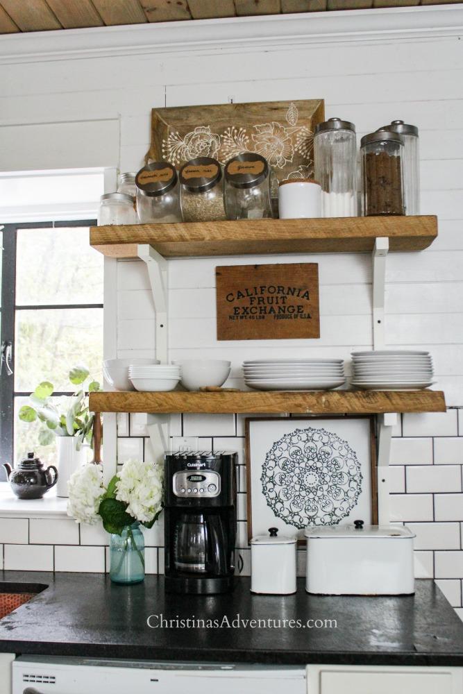 farmhouse style kitchen open shelving black countertops