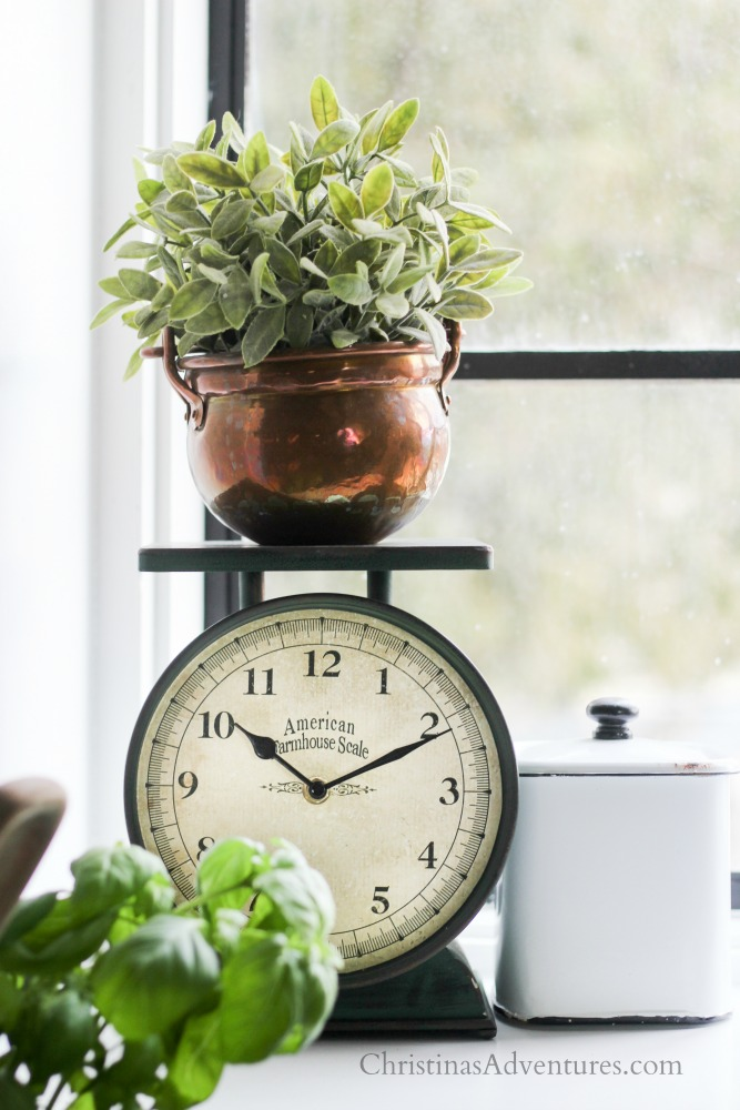 farmhouse style scale with clock in the kitchen