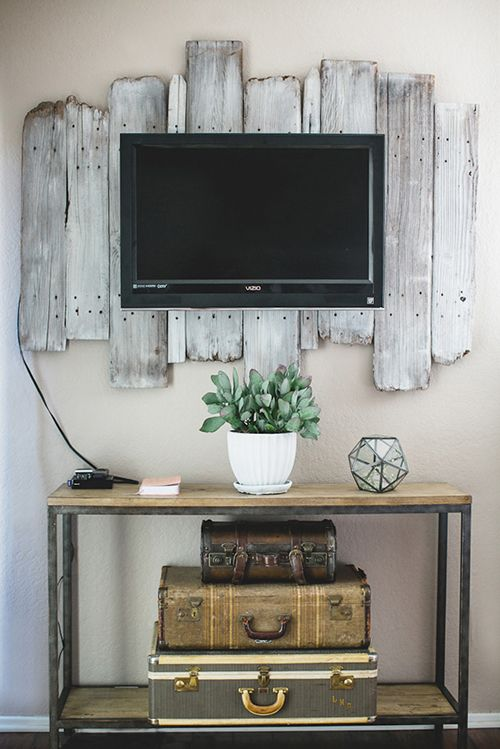 distressed barn wood behind a TV
