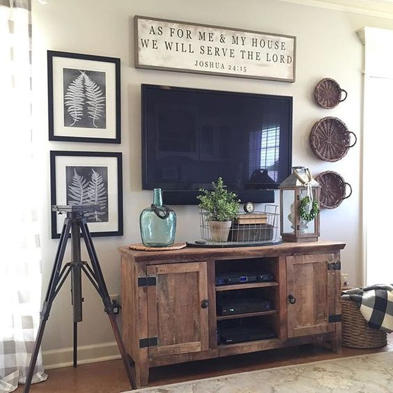 Farmhouse style gallery wall around a wall mounted TV