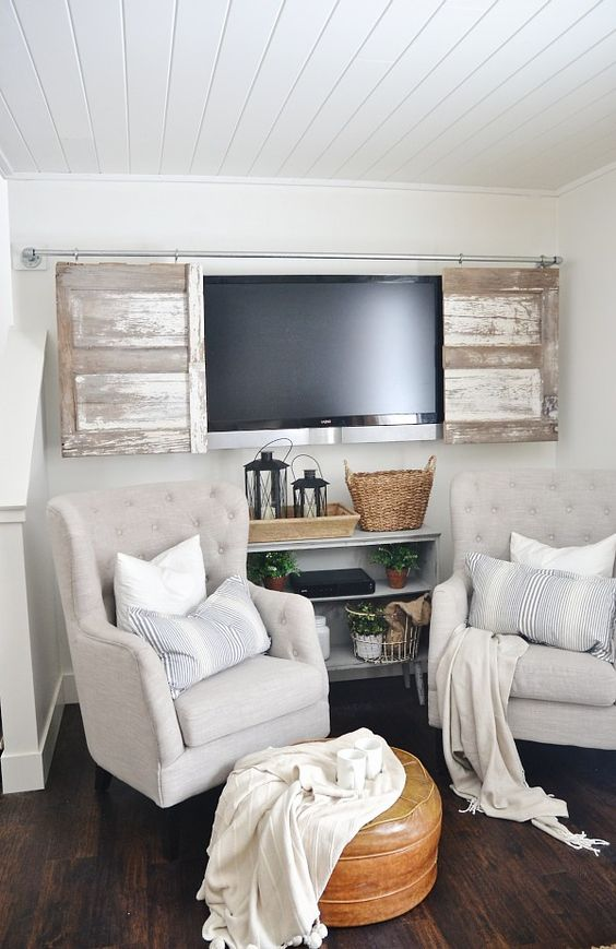 wall mounted TV with distressed sliding barn door cover