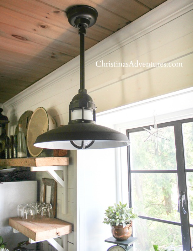 farmhouse kitchen lighting over the kitchen sink