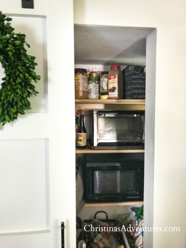 idea to hide a microwave in a kitchen pantry
