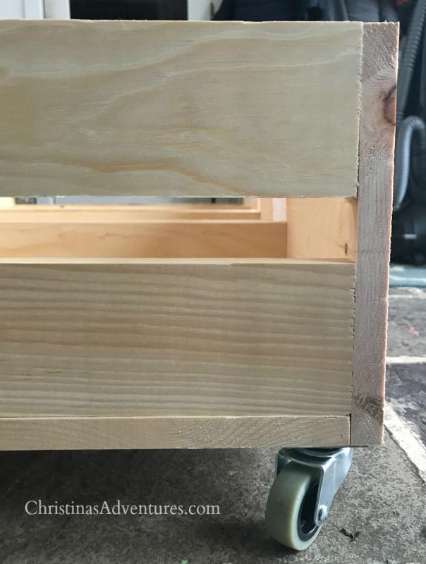 wood storage box on caster wheels