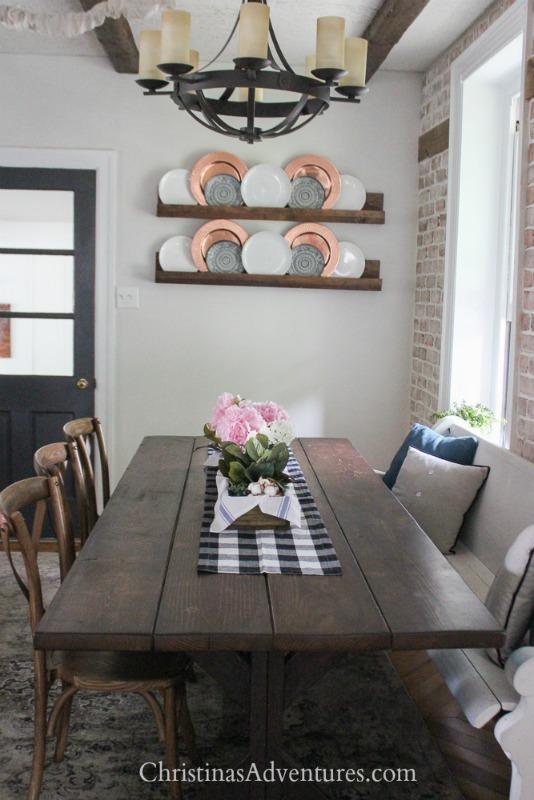 farmhouse dining table with buffalo check table runner
