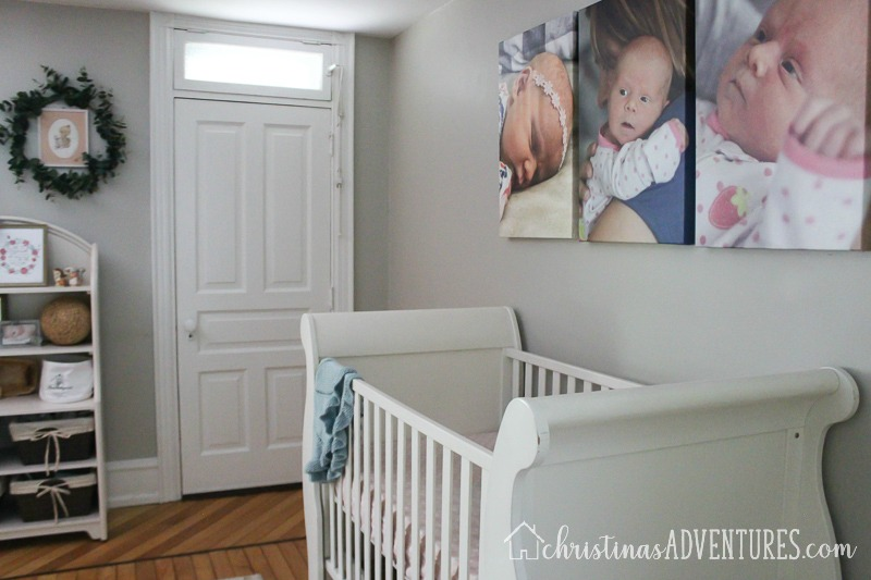 neutral nursery with white crib and gray walls